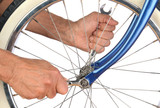 Closeup Man Tightening Bicycle Wheel