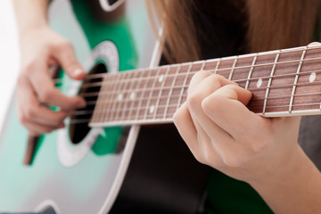 Beautiful girl with guitar  on white background