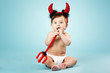 Постер, плакат: little funny baby with devil horns and trident