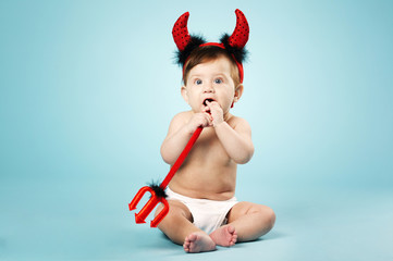 little funny baby with devil horns and trident