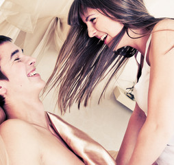 Side view of a romantic couple having fun in bed