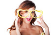 Funny woman with heart shape sunglasses