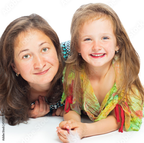 Portrait of joyful mother and her daughter