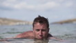 Happy man relaxing in sea, super slow motion, shot at 240fps