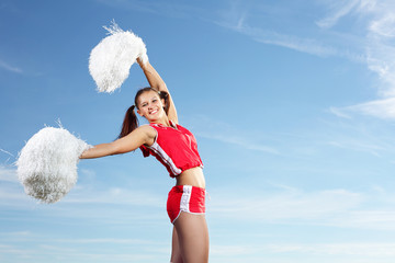 Young female cheerleader