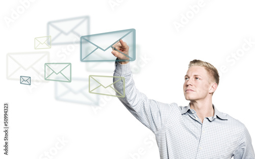 Young businessman selecting mail icon in the air.