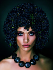 Autumn Woman with Grapes on her Head. Trendy Hairstyle