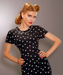 Styled Woman in Blue Retro Polka Dot Dress. Pin Up Style