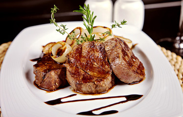 Beef steak with soy sauce, rosemary and onion