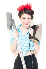 Beautiful young house wife with iron & vacuum cleaner on white