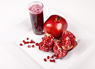 Pomegranate and juice in glass