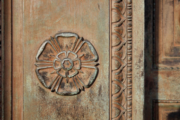 Carved Tudor Rose on a vintage doorway
