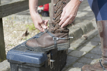 Fitting a spur onto a riding boot