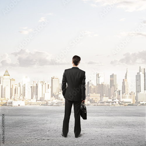 man and looking at city