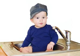The baby plumber repairs water tap