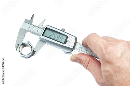 A man measures the piece caliper. Close-up.