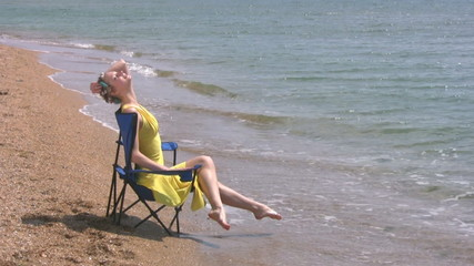 Beach, yellow dress, blue chair