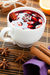 mulled wine with almonds in a white cup
