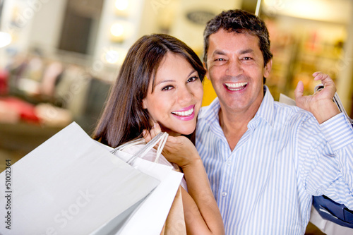 Shopping couple smiling