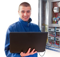 Handyman working with laptop