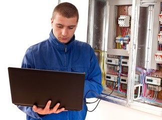 Electrician working with laptop