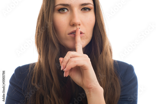 woman holds a finger near the mouth
