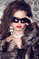 Luxury and Fashion Portrait of stylish woman model with sunglass