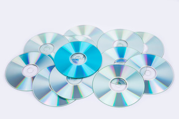 one blue and several normal CD DVD discs