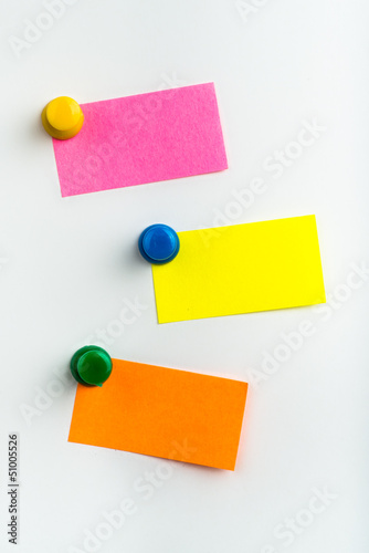 Three empty reminder notes on a white background
