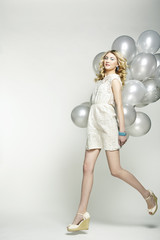 Fashion photo of beautiful woman with balloon. Girl posing