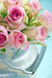 Bouquet of pink roses in a rustic bucket