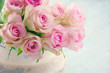 Pink roses in a shabby chic metal bucket