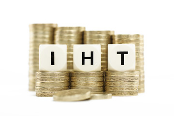IHT (Inheritance Tax) on gold coins on white background
