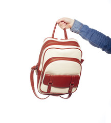 student holding backpack