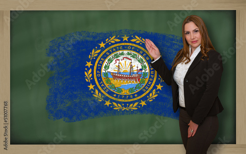 Teacher showing flag ofnew hampshire on blackboard for presentat