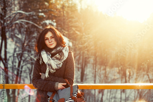 outdoor closeup of young pretty teenage girl in cold weather