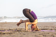 Slim woman standing on her head  doing yoga –upside down