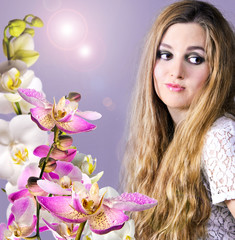 Beautiful blond woman with orchid flowers