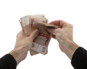 man's hands recalculates cash in Russian rubles