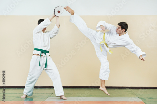 Two man at taekwondo exercises - 51009308
