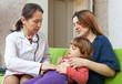 mature children's doctor examining baby