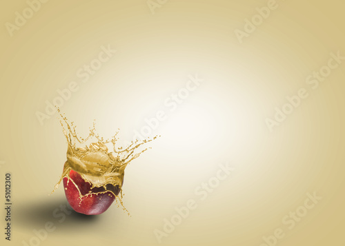 fresh juice pouring out of the apple