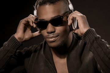 Afro American Guy with headphones listen to music