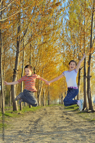 children play in forest