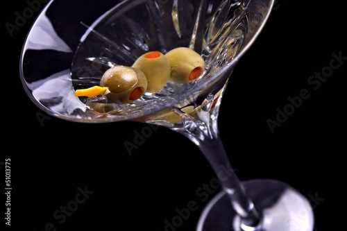 Martini on black with olives tilted