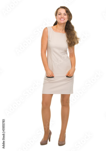 Full length portrait of happy young woman