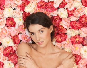 beautiful woman and background full of roses