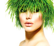 Beauty Spring Woman with Fresh Green Grass Hair. Summer Nature
