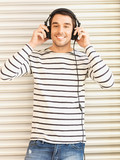 man in casual clothes with headphones