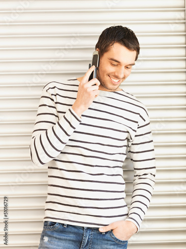 man in casual clothes talking on the phone